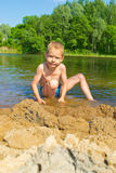 Boy builds a sand Royalty Free Stock Photos