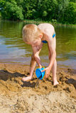 Boy builds a sand Stock Photos