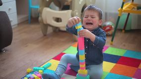 The boy built the building, the tower fell, the child was very upset. HD 1920x1080 stock video
