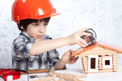 Boy built a new house Royalty Free Stock Photos