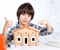 Boy built a new house Royalty Free Stock Image