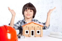 Boy built a new house Stock Images