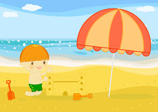 Boy builts sand castle on the beach. Illustration about a cute little boy buildings castles in the sand on the beach at seaside Stock Photography