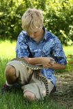Boy with bullsnake Royalty Free Stock Photos