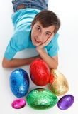 Boy with a bunch of chocolate easter eggs Royalty Free Stock Image