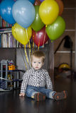 Boy with bunch of colorful balloons Royalty Free Stock Photography