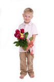 Boy with Bunch of Flowers Stock Photos