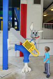 A boy and Bunny with a Chain Saw at LEGOLAND Florida Royalty Free Stock Photography