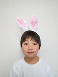 Boy in bunny ears Stock Photo