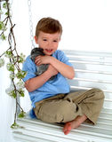 Boy and Bunny on Swing Royalty Free Stock Image