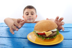 Boy and burger stock image