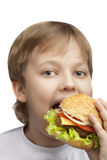 Boy with burger Royalty Free Stock Images