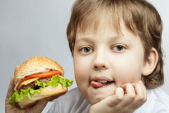 Boy with burger Stock Photography
