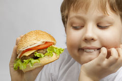 Boy with burger Stock Photo