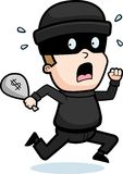 Boy Burglar. A cartoon burglar boy scared and running away Stock Images