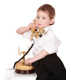 Boy in business suit with telephone. Royalty Free Stock Photos