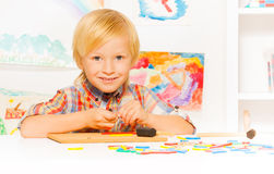 Boy busy with developmental game Royalty Free Stock Photography