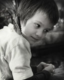 Boy and a Butterfly. Blue Morpho Butterfly on the shoulder of a little boy Royalty Free Stock Photos