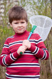 Boy with a butterfly net Stock Photo
