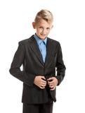 Boy buttoning jacket Royalty Free Stock Photo
