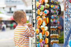 Boy buying gifts Royalty Free Stock Images