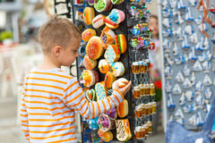 Boy buying gifts Stock Images