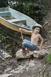 Boy By Boat On Lake Royalty Free Stock Photo