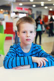 Boy in the cafe Royalty Free Stock Photography
