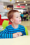 Boy in the cafe Stock Photo