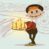 The boy with a cake Royalty Free Stock Image