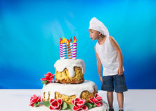 Boy with a cake Royalty Free Stock Photography