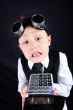 Boy with calculator royalty free stock images