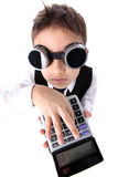 Boy with calculator Stock Images