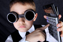 Boy with calculator Royalty Free Stock Image