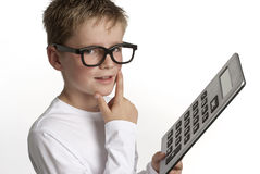 Boy with Calculator. Clever looking boy with caculator. Shot in studio on white background Stock Images