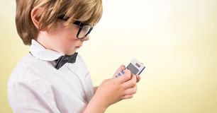 Boy with calculator against yellow background Royalty Free Stock Photos