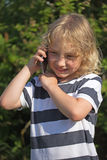 Boy is calling outdoors Stock Image
