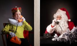 Boy calls to Santa and tell about his wishes for the christmas p. Resents. Studio shot Royalty Free Stock Photos