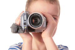 Boy with camcorder Royalty Free Stock Photos