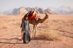 Boy with camel. Bedouin boy, with camel in the desert, Jordan stock photos