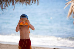 Boy with camera Stock Photography