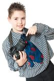 Boy and camera Stock Photos