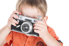 The boy and a camera Royalty Free Stock Photography