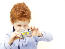 Boy with camera Stock Photos