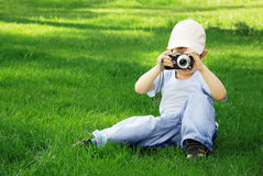 Boy with the camera Stock Image