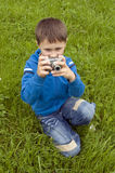 Boy with the camera in hands. Royalty Free Stock Photo