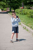A boy with a camera in park Royalty Free Stock Image
