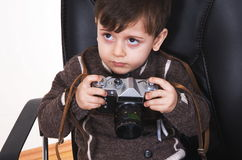 Boy with camera Stock Images