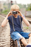 boy with camera at railways Stock Photos