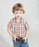 Boy with a camera Stock Photo